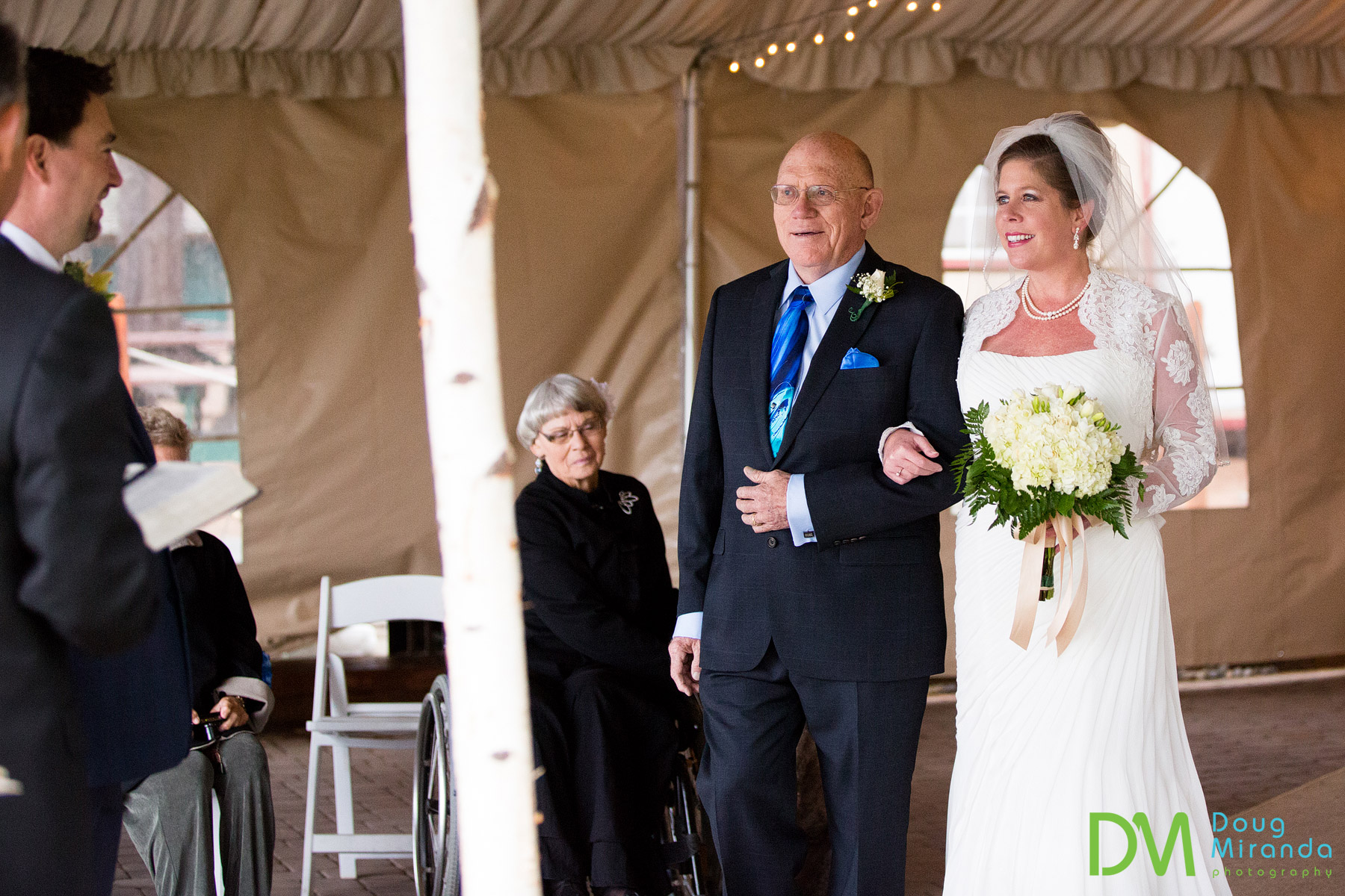 a bride and her dad during her wedding ceremony