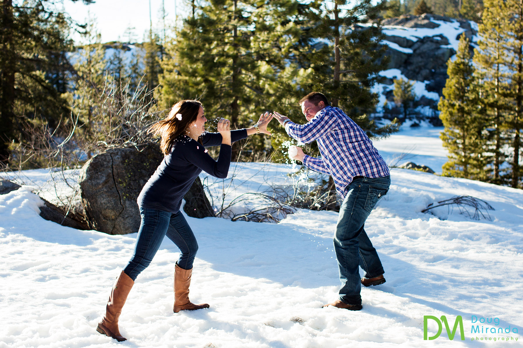 Leslie and Jerrod playing around in the snow at the end of the engagement session.
