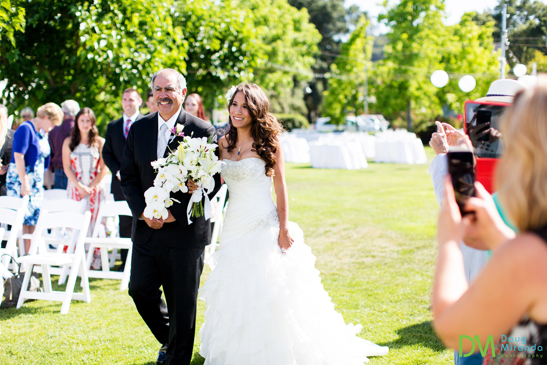 Rosie and her dad walking down the aisle at the start of her Geyserville Inn wedding ceremony