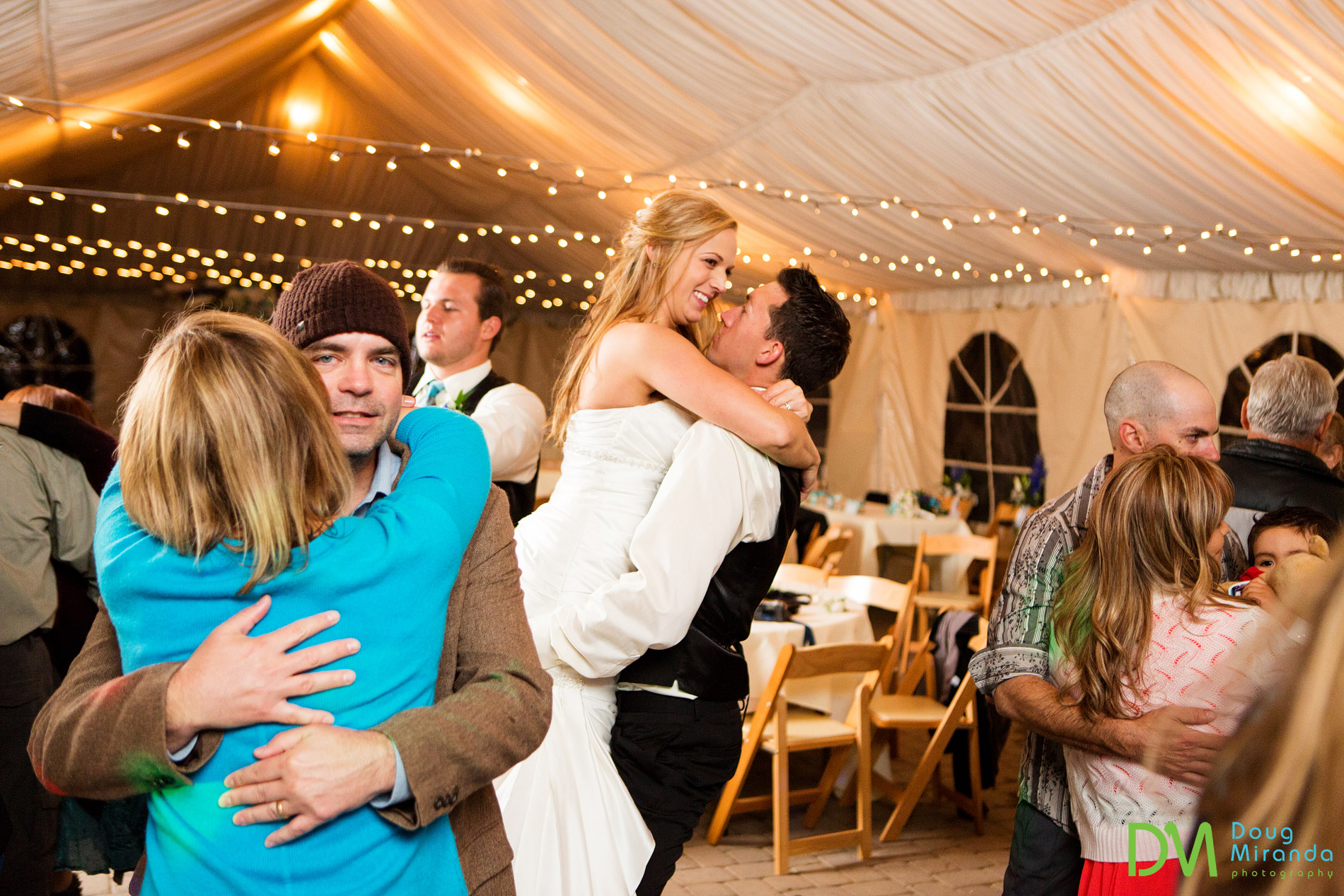 Dancing the night away to stay warm on a rainy wedding night.